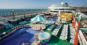 Norwegian Gem cruise ship Tahitian Pool is the main pool on the ship.