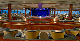 Norwegian Gem cruise ship Spinnaker Lounge with horizontal windows and a view of