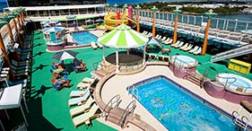Norwegian Jade cruise ship Pool with slides, hot tubes, and deck chairs.